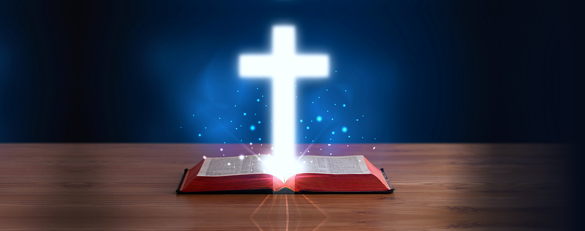 a cross above the bible